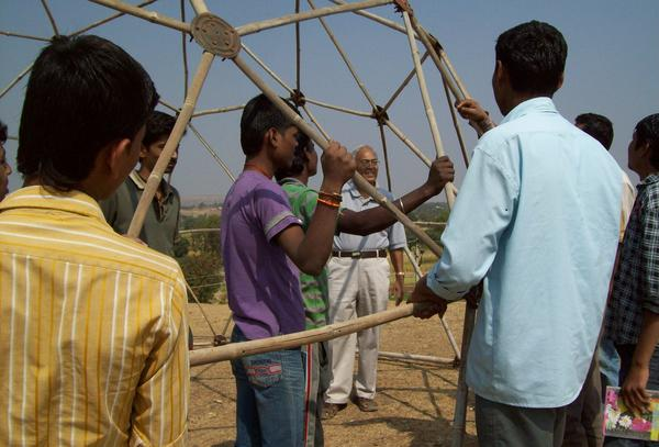 Students looking at the previously built bamboo dome at Vigyan Ashram, Pabal