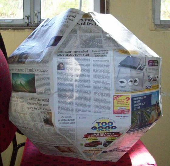 Rhombicuboctahedron made of newspaper broadsheets